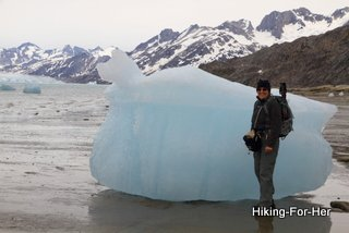An ice chunk as tall as a hiker!