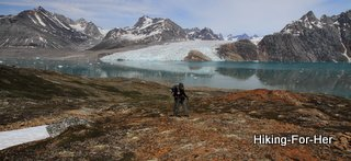Karale Glacier in East Greenland with hiker in foreground