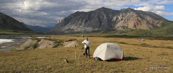 Group hiking trip in the backcountry, with backpacking tents spread far apart from each other