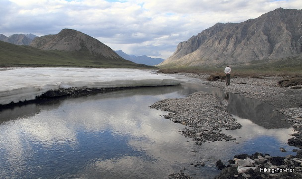 female hiker enjoying solitude on the Canning River, ANWR Alaska