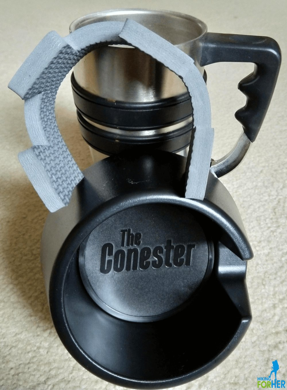 The Conester mug holder with foam insert and a metal travel mug