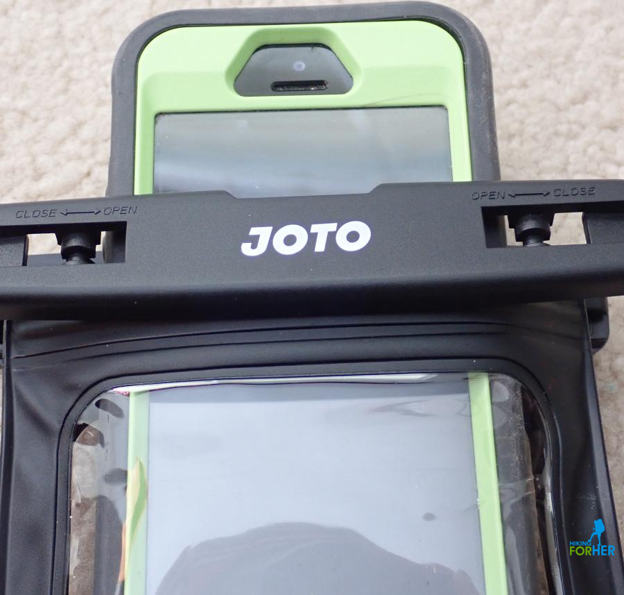 Green and gray Otterbox around iphone and Joto waterproof case