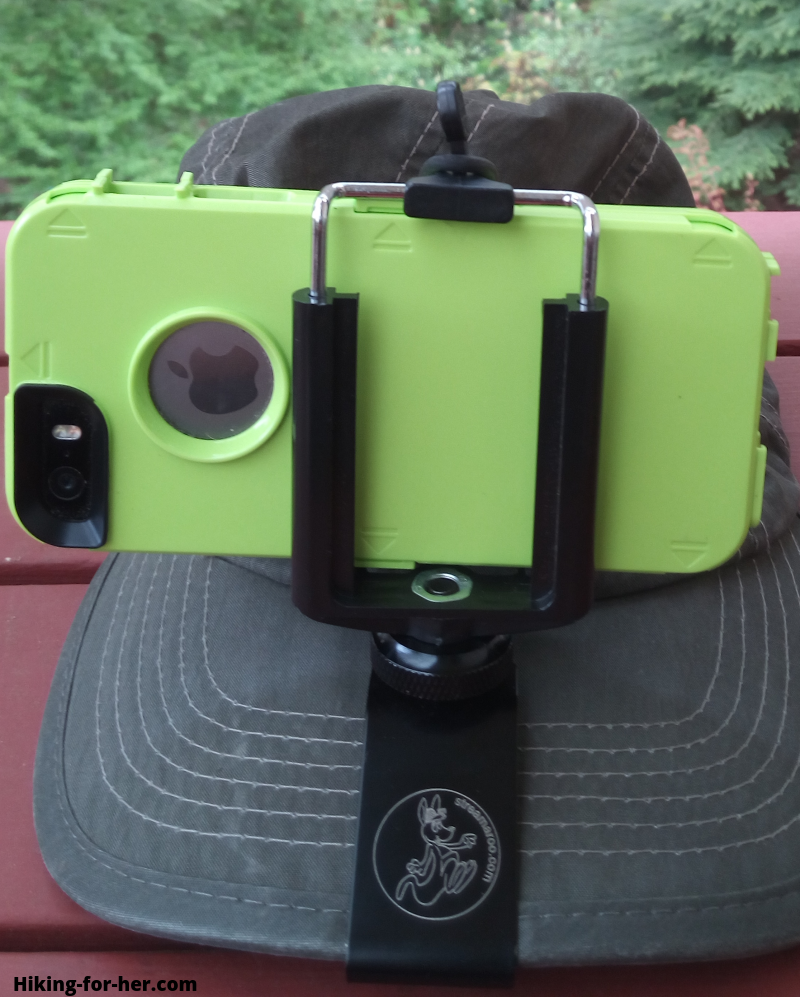 Green smartphone attached to a hiking hat for making POV videos