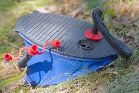 Old style foot pump to inflate an air mattress