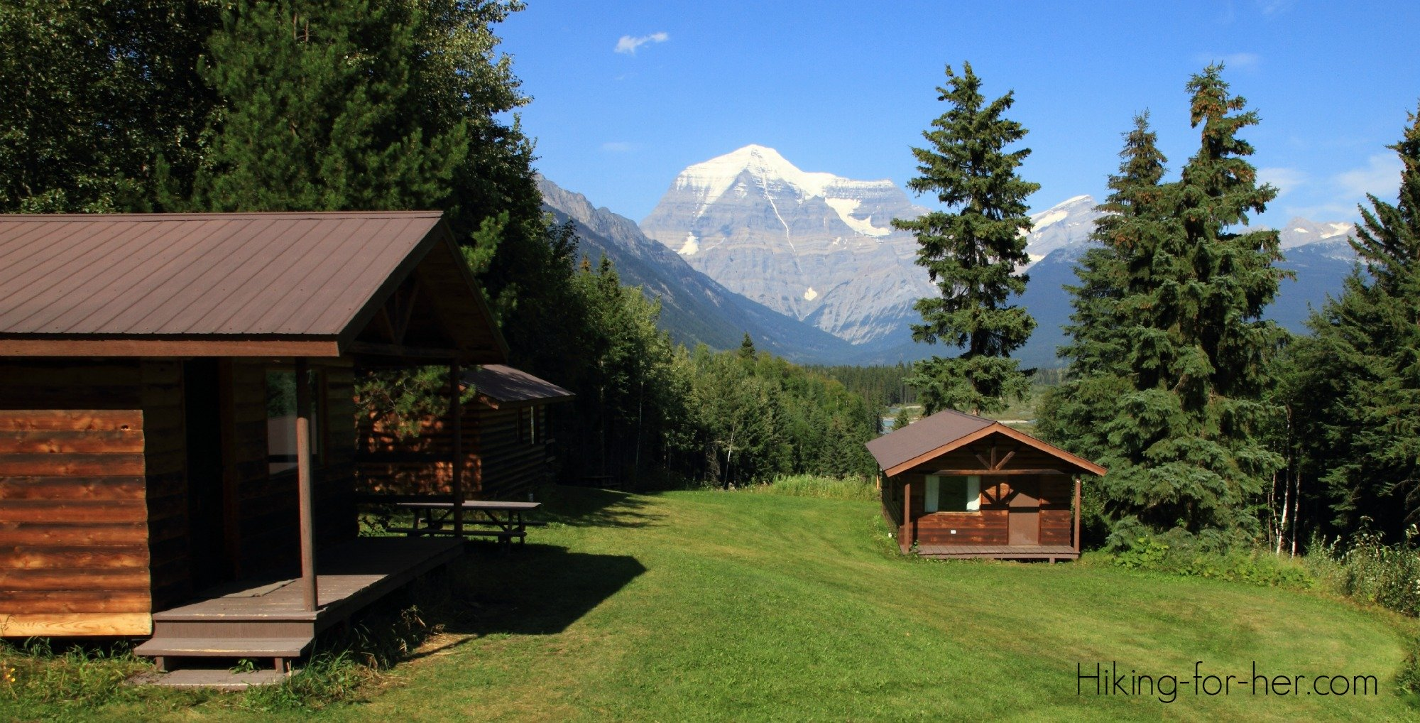 Mt. Robson, British Columbia, with log cabin in foreground